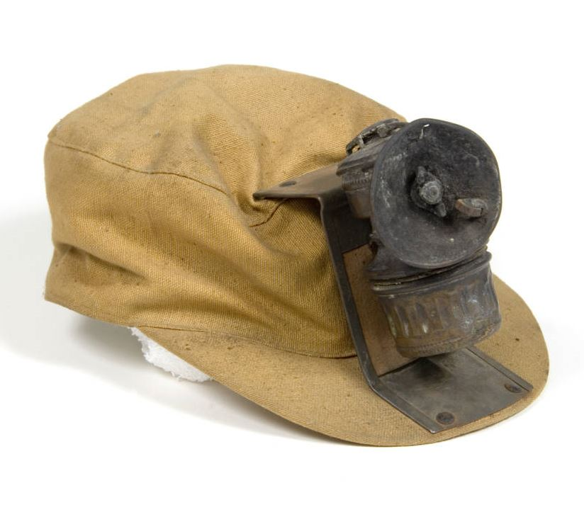 Cap, cloth with metal clip and brass carbide lamp Image